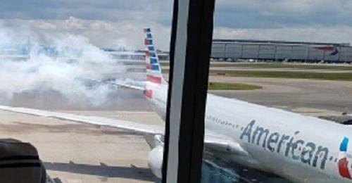 بالفيديو والصور: إخلاء طائرة أميركية في مطار لندن بعد اندلاع حريق