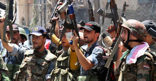 مقاتلو الاسد يتخرجون على المذهب الشيعي بمركز في حماه قادته ايرانيين