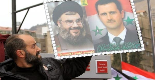 شعارات تهاجم الأسد ونصرالله في صور