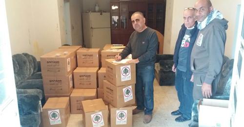 """بالصور: توزيع مساعدات من """"القوات"""" في صيدا – الزهراني"""