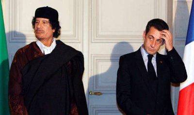 القذافي ونجله سيف الإسلام يشهدان ضد ساركوزي!