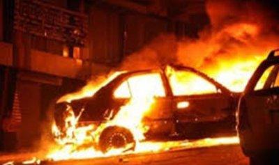 اخماد حريق في سيارة على طريق النجارية