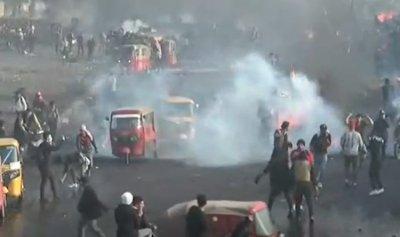 قتيل وجرحى بمواجهات المتظاهرين والأمن في بغداد