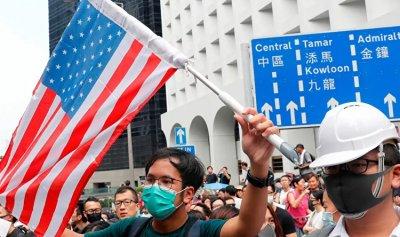 الصين تفرض عقوبات على مسؤولين أميركيين
