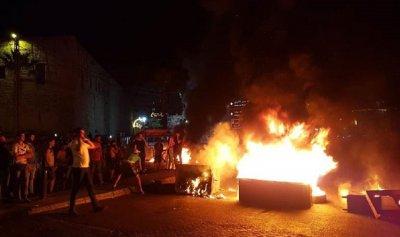 اختناق عاملين اجنبيين بدخان الاحتجاجات
