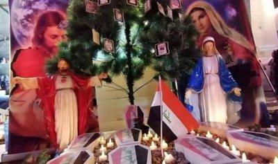 أشجار الميلاد تتزين بصور ضحايا العراق