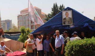 إزالة خيمة العسكريين المتقاعدين من ساحة الشهداء