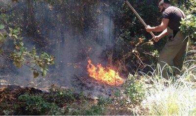 بالصورة: إخماد حريق في نهر إبراهيم
