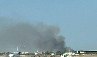 بالفيديو والصور: حريق ضخم في مطار برشلونة