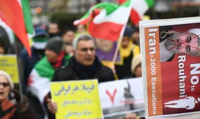 أنصار المجلس الوطني للمقاومة الإيرانية يحتجون على زيارة ظريف بلجيكا