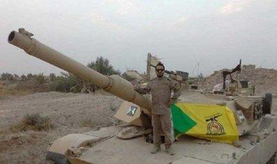 """علم """"حزب الله"""" يرفرف على دبابات """"أبرامز"""" الأمريكية… كيف ذلك؟"""